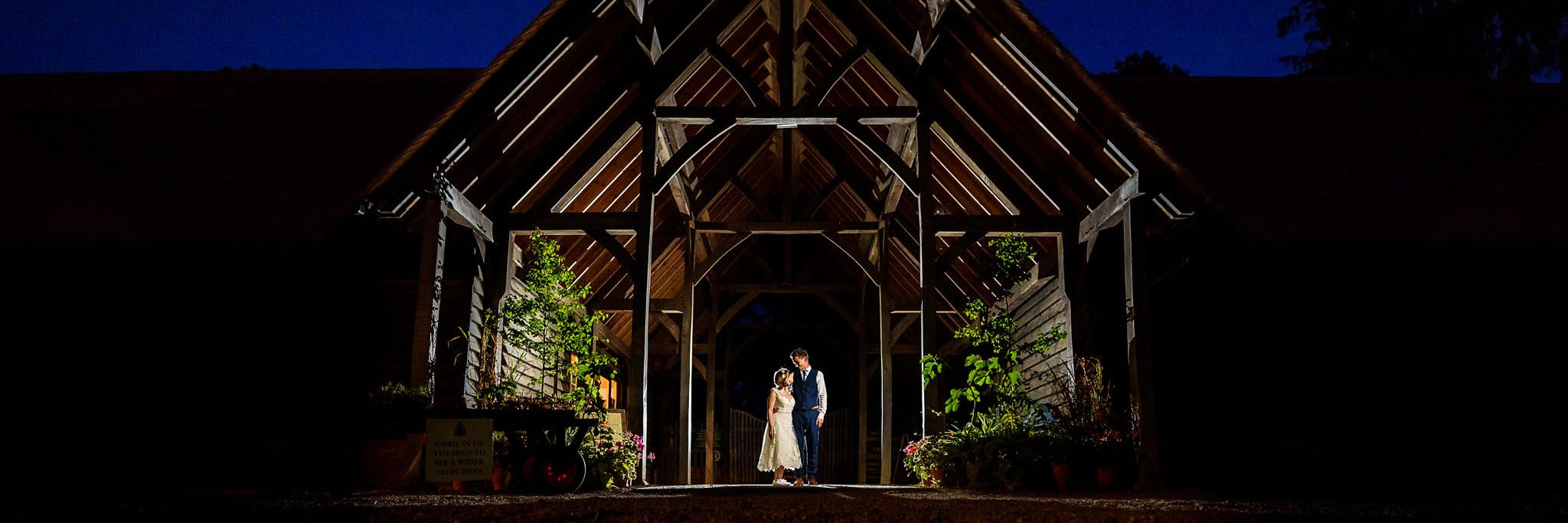 evening photo of the happy couple at knebworth barns