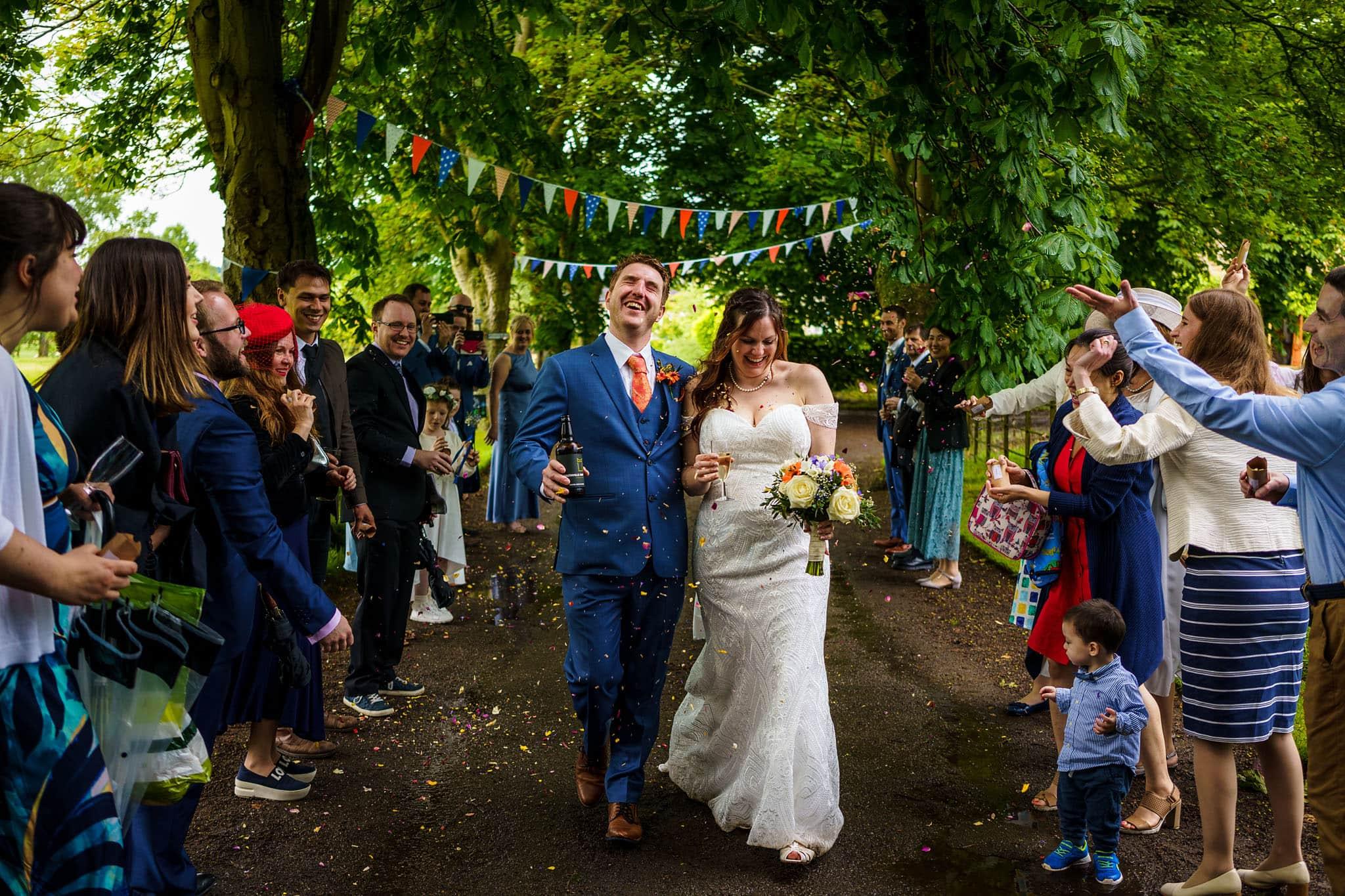 confetti walk for the bride and groom at Talton Lodge