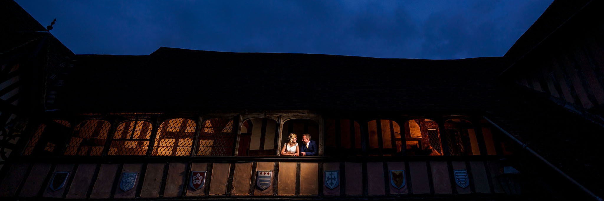 bride and groom shot at night time at Lord Leycester Hospital