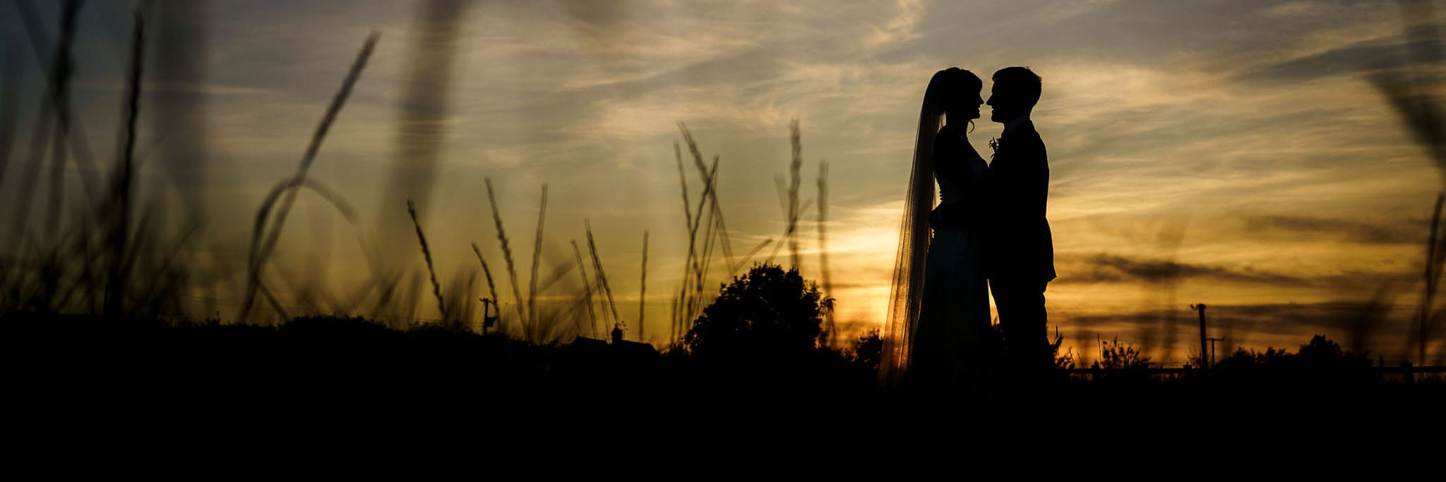 bride and groom sunset silhouette at Cider Mill Barns
