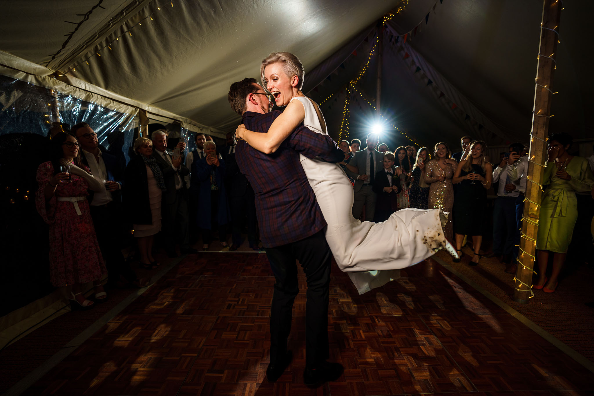 groom spinning his bride around during the first dance