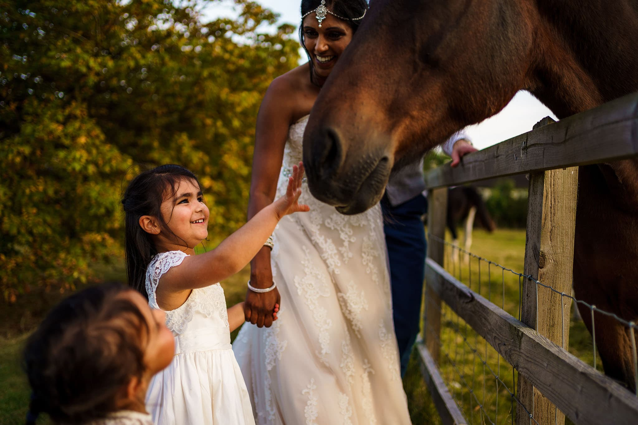 flower girl meeting a horse at a Cotswolds wedding