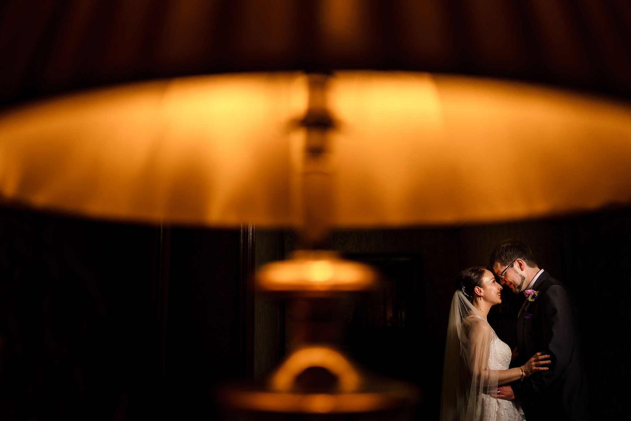 atmospheric portrait of the bride and groom at Mallory Court
