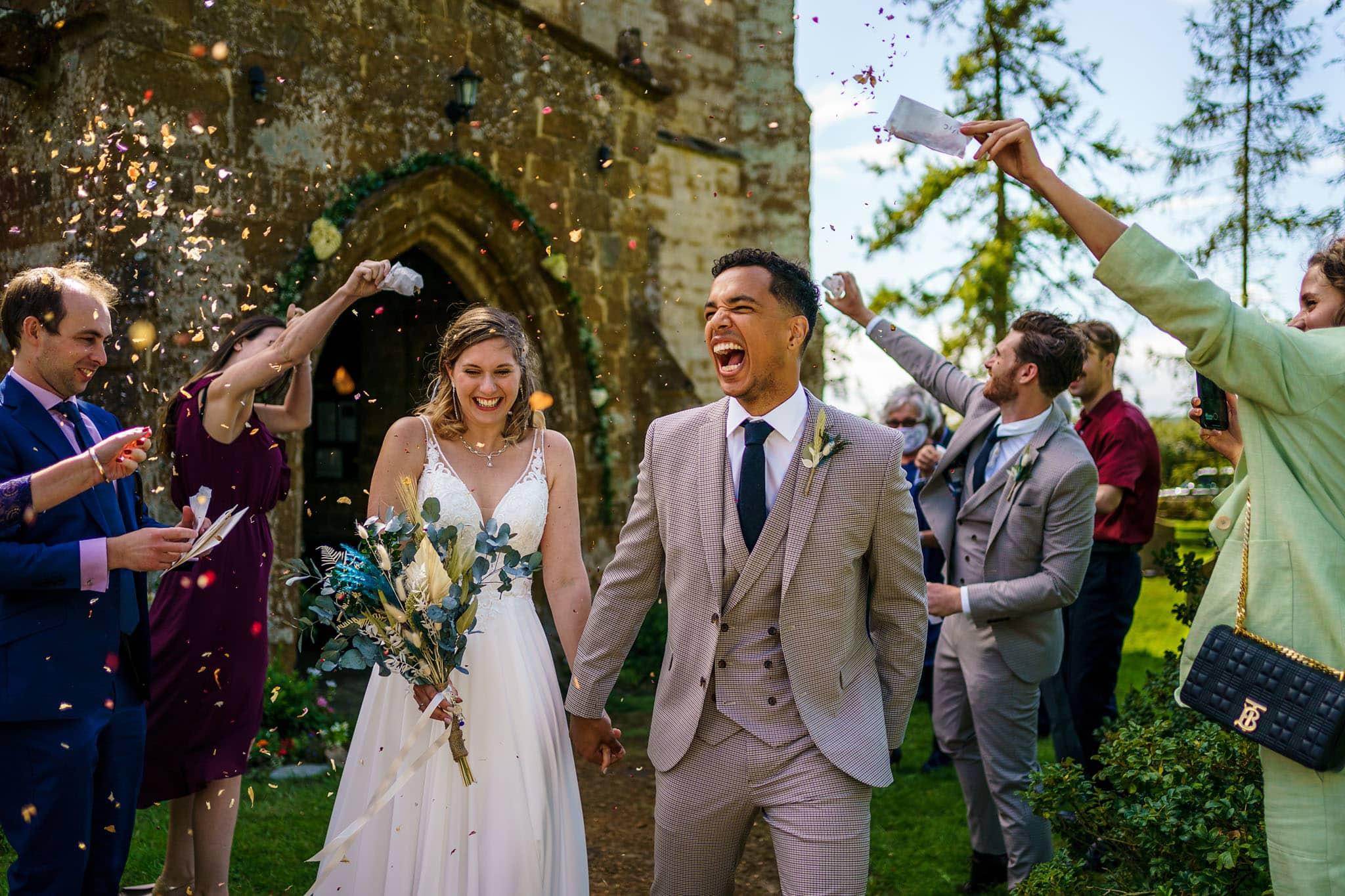 Oxhill wedding photography happy confetti shot