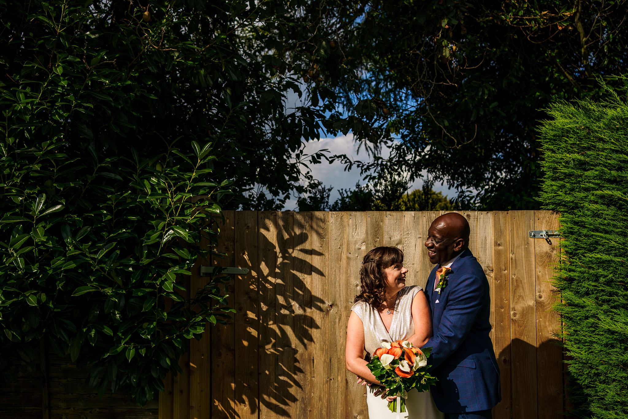 portrait of the bride and groom in the sunshine