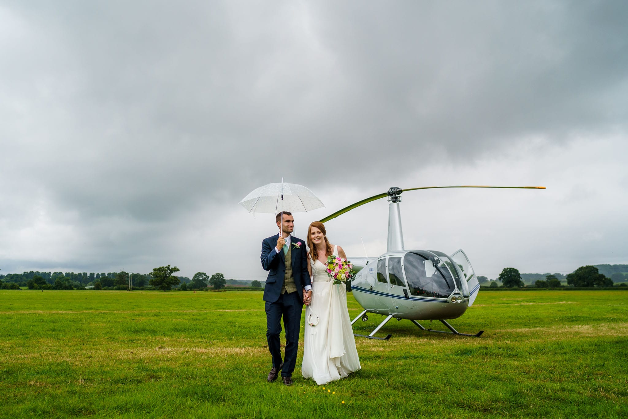 bride and groom arriving in a helicopter