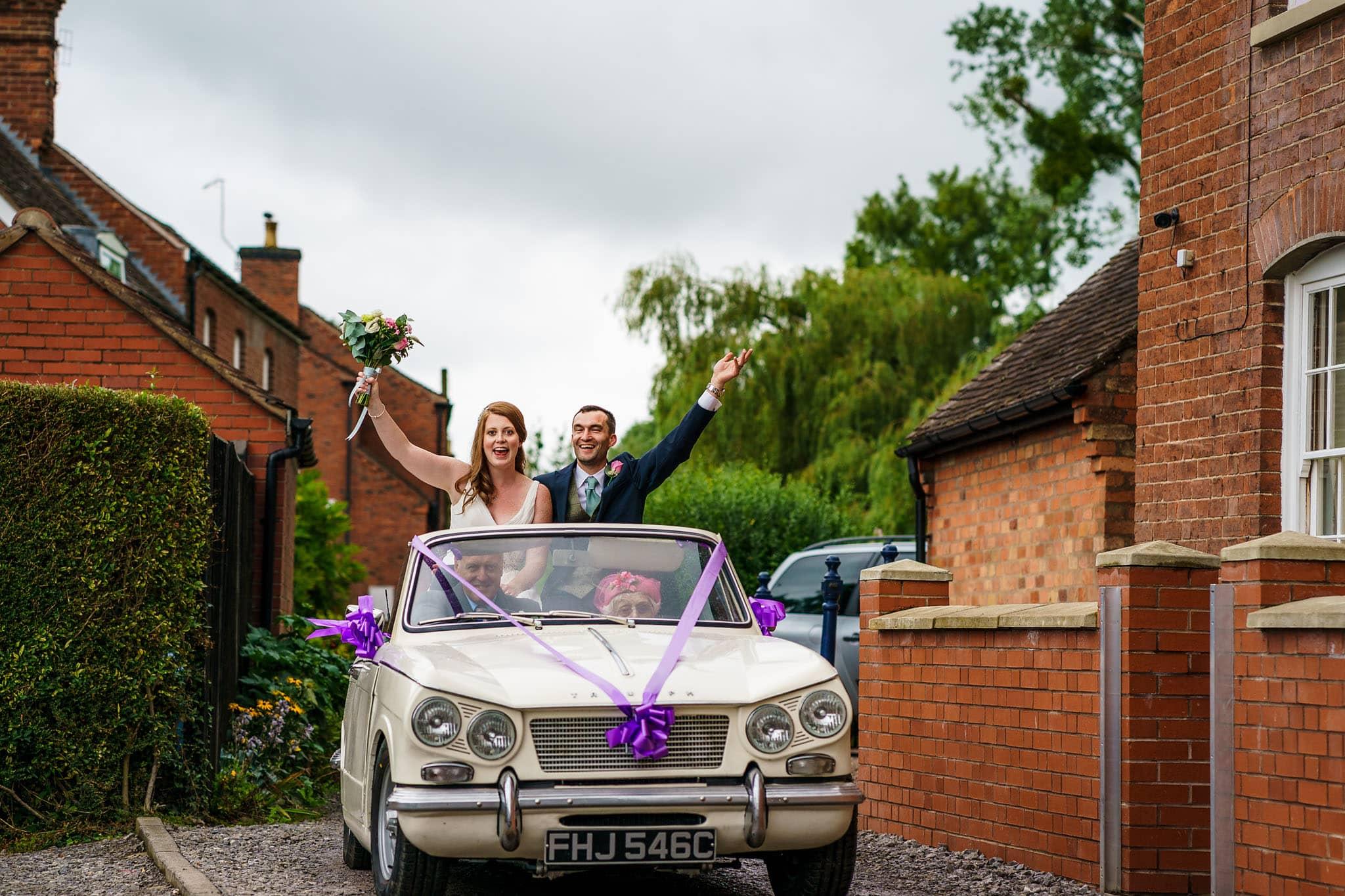 bride and groom arrival in vintage car